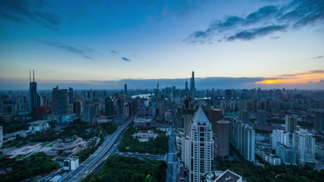high up view of shanghai urban cityscape dawn to day transition - 東方明珠塔点の映像素材/bロール