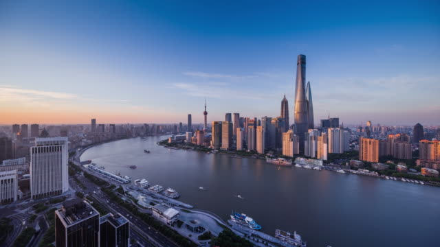 high up view of shanghai urban cityscape day to night transition - 東方明珠塔点の映像素材/bロール