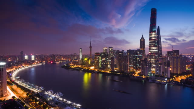 high up view of shanghai urban lujiazui financial center night to day transition - 東方明珠塔点の映像素材/bロール