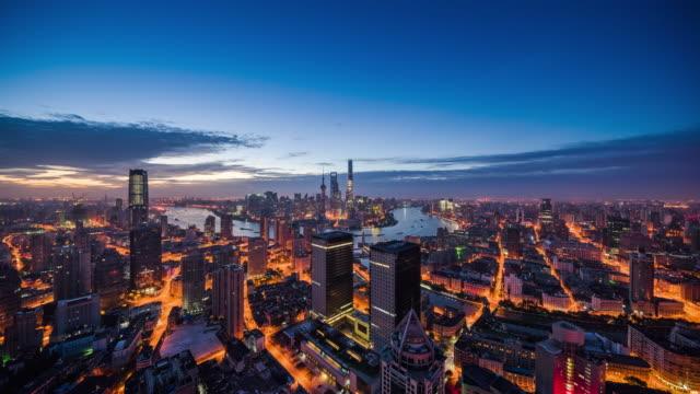 high up view of shanghai urban skyline dawn to day transition - 東方明珠塔点の映像素材/bロール