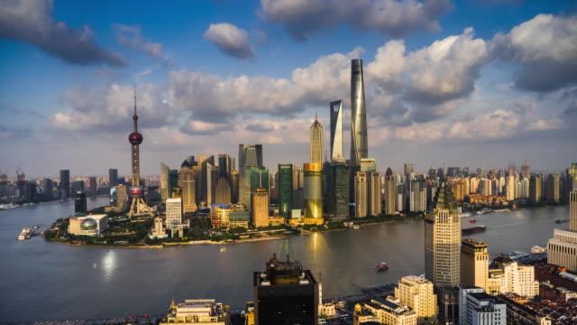 high up view of shanghai urban skyline day to dusk transition - 東方明珠塔点の映像素材/bロール