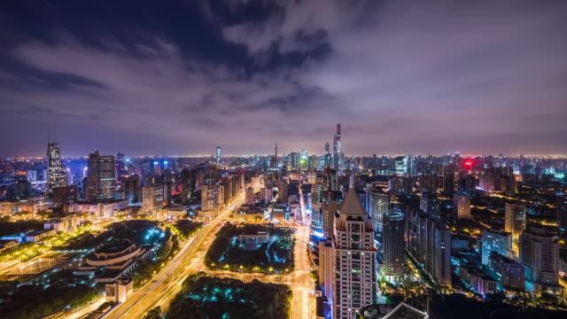 high up view of shanghai urban skyline nightscape transition - 東方明珠塔点の映像素材/bロール