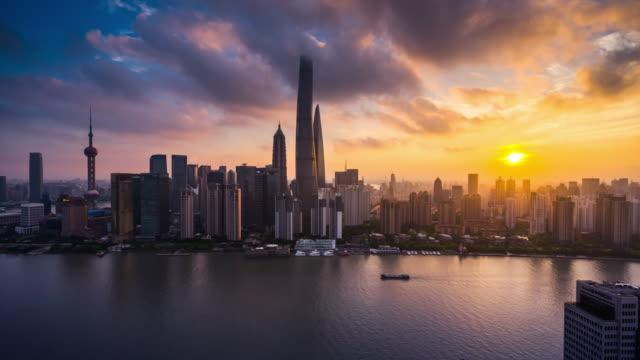 high up view of shanghai urban skyline sunrise to day transition - 東方明珠塔点の映像素材/bロール