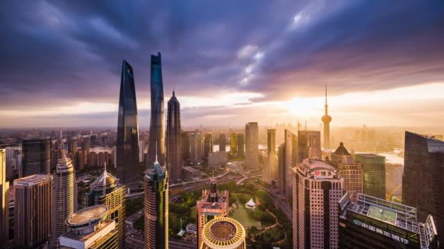 high up view of shanghai urban skyscrapers dusk to night transition - 東方明珠塔点の映像素材/bロール