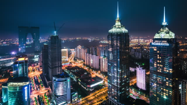 high up view of suzhou financial district night transition - bildkomposition und technik stock-videos und b-roll-filmmaterial
