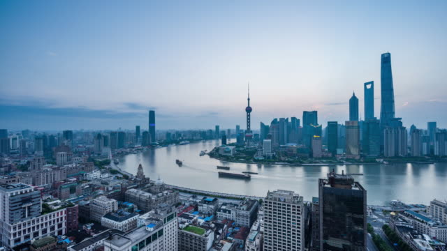 high up view of urban shanghai cityscape and shanghai the bund dawn to day transition - dawn to day stock videos & royalty-free footage