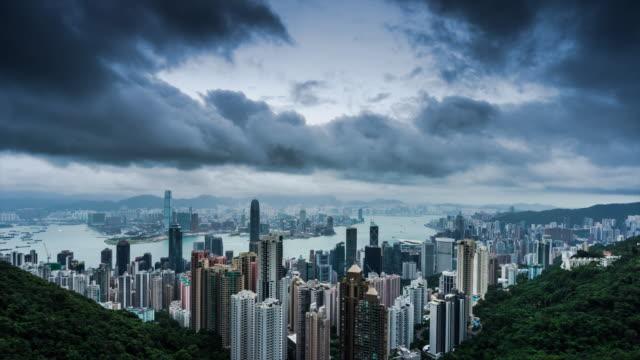 hong kong high up view transition on a cloudy day - hong kong stock videos & royalty-free footage