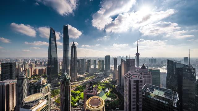 high up wide shot of shanghai lujiazui financial center skyscrapers daytime transition - wolkenloser himmel stock-videos und b-roll-filmmaterial
