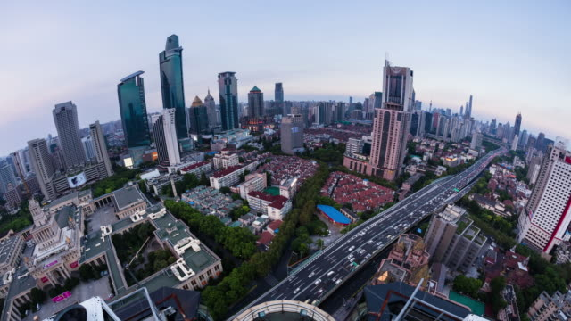 high up wide spherical view of shanghai urban cityscape and road dusk to night transition - 東方明珠塔点の映像素材/bロール