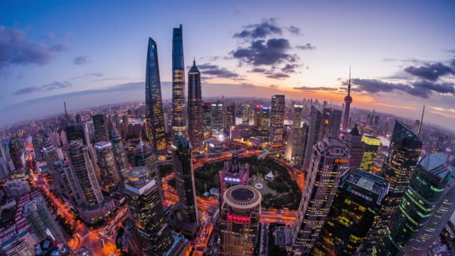 high up wide spherical view of shanghai urban cityscape dusk to night transition - 東方明珠塔点の映像素材/bロール