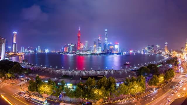 high up wide spherical view of shanghai urban skyline and urban road nightscape transition - 東方明珠塔点の映像素材/bロール