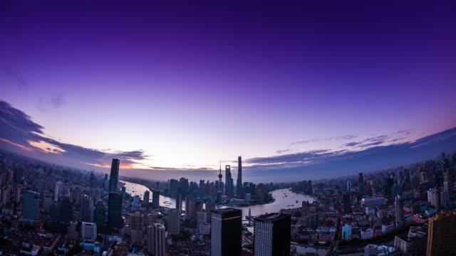 high up wide spherical view of shanghai urban skyline dawn to sunrise transitiion - 東方明珠塔点の映像素材/bロール