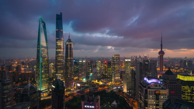 high up wide view of shanghai lujiazui financial center dusk to night transition - high up stock videos & royalty-free footage