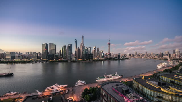 high up wide view of shanghai north huangpu river and lujiazui financial center dawn to day transition - dawn to day stock videos & royalty-free footage