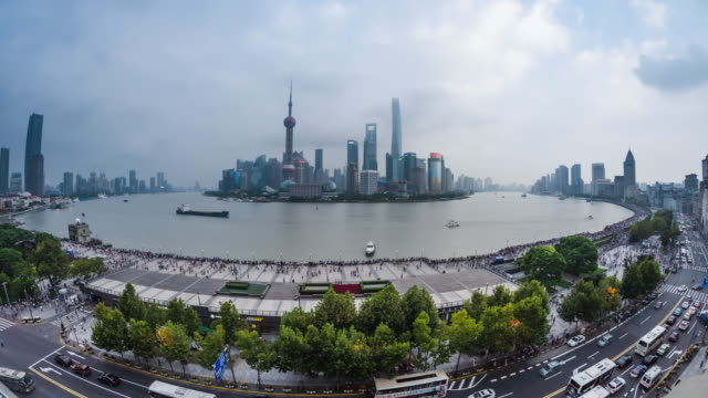 high up wide view of shanghai the bund city skyline and urban road day to dusk transition - 東方明珠塔点の映像素材/bロール