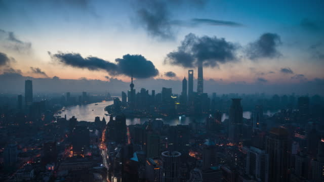 high up wide view of shanghai urban cityscape dawn to day transition - dawn to day stock videos & royalty-free footage