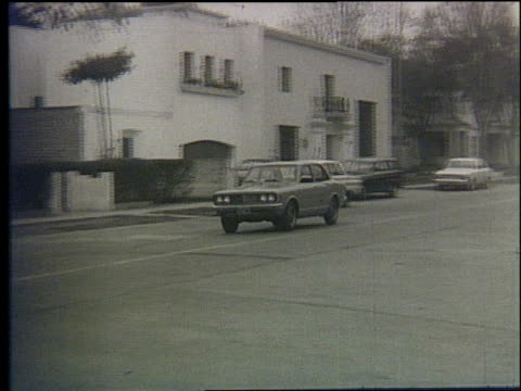 high view of city roads toyota cars driving down streets toyota cars driving around on september 05 1972 in ventanilla peru - 1972 stock videos and b-roll footage