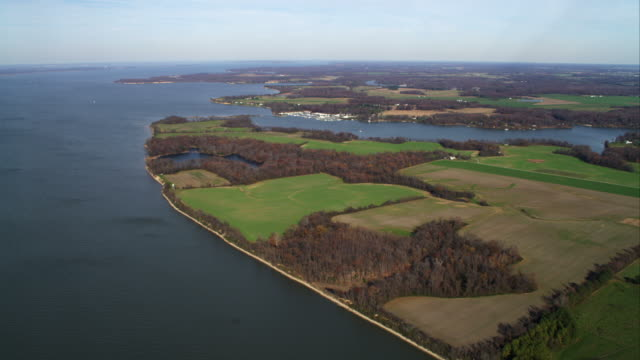 high view of coastal farmland east of chesapeake bay, maryland. shot in november 2011. - maryland delstat bildbanksvideor och videomaterial från bakom kulisserna