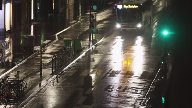 high view street of paris in the rain at night - road signal stock videos & royalty-free footage