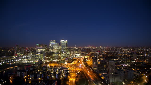 High viewpoint, panoramic of Canary Wharf and The City of London at dusk