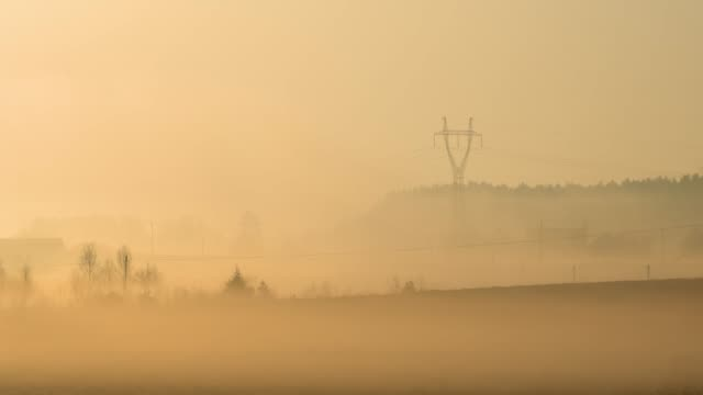 high voltage pole in the fog - electricity pylon stock videos & royalty-free footage