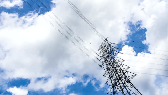 high voltage poles under blue sky - high voltage stock videos and b-roll footage