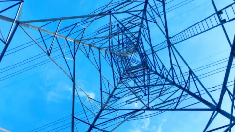 high voltage tower with sky background - high voltage sign stock videos & royalty-free footage