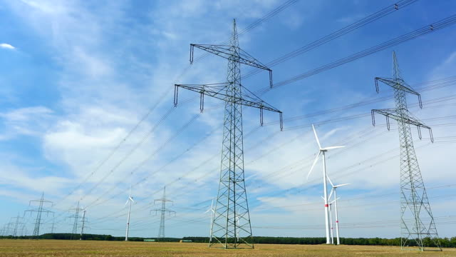 high voltage towers with wind energy - electricity pylon stock videos and b-roll footage