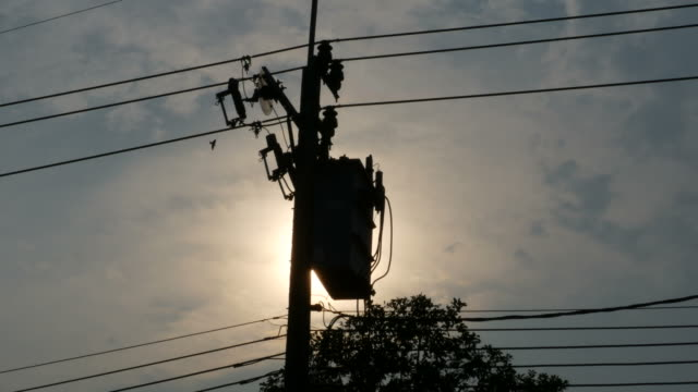 high voltage transformer with sunset background - curve stock videos & royalty-free footage