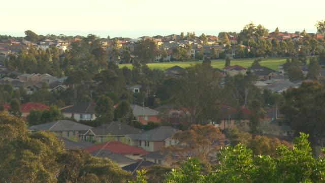 high wide shot Beaumont Hills outer suburban housing set amongst trees
