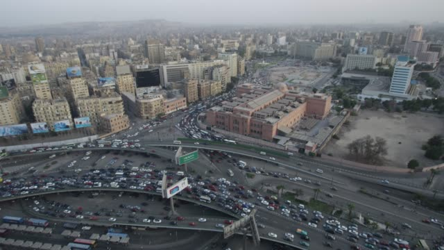 a high, wide view of traffic in central cairo, egypt. - museum stock videos & royalty-free footage