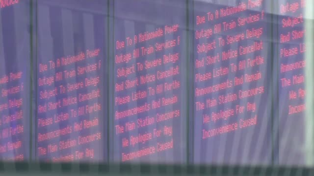 high winds and flooding cause travel disruption across uk england london king's cross station int electronic sign board showing apology notice for... - flapping stock videos & royalty-free footage