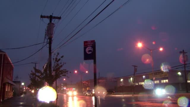 vídeos de stock, filmes e b-roll de high winds and rain batter a street during hurricane sandy. - high street