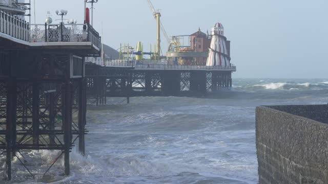 high winds hit the south of england, as storm force winds hit parts of the uk, brings large waves and choppy seas next to brighton pier on march 11,... - rough stock videos & royalty-free footage