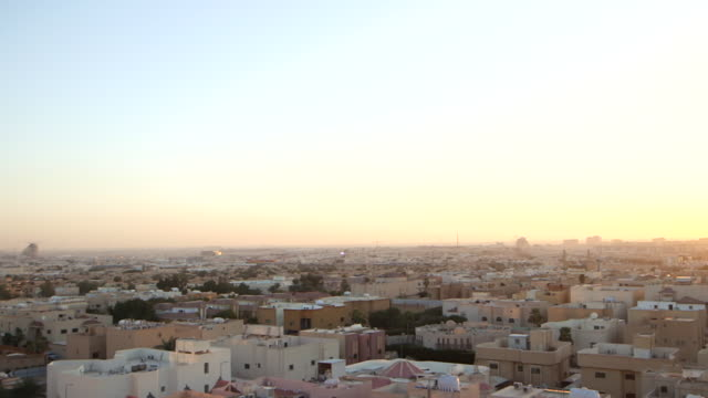 high-ange views of the riyadh cityscape as the sun is beginning to set. - cityscape stock videos & royalty-free footage