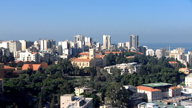 vídeos de stock, filmes e b-roll de high-angle cityscape, with the american university of beirut campus in the foreground. the campus overlooking the mediterranean is one of the... - península