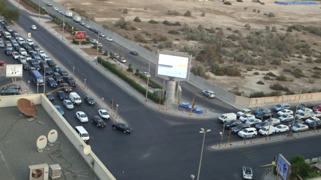 high-angle of traffic on a road in jeddah. - jiddah stock videos & royalty-free footage