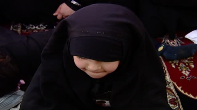 highangle cu on a little shia girl in chador during ashura which is a mourning rite commemorating the death of hussain ibn ali organised by hezbollah... - religiöse kleidung stock-videos und b-roll-filmmaterial