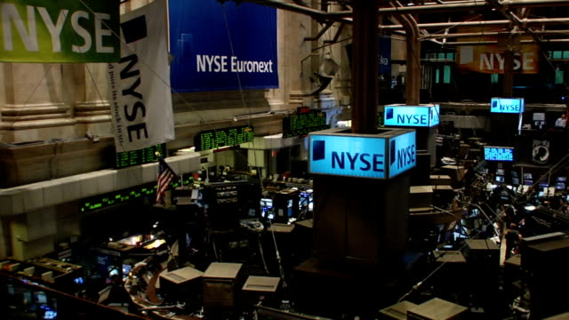 high-angle pan r to l over trading floor of new york stock exchange new york city - bull market stock videos & royalty-free footage