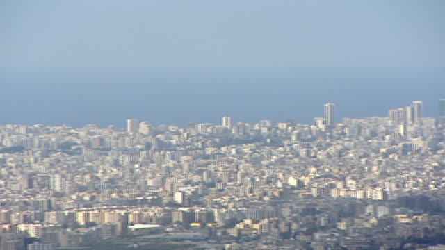 high-angle pan-left across the beirut peninsula jutting out into the mediterranean sea showcasing the cheek-by-jowl nature of its urban development. - peninsula stock videos & royalty-free footage
