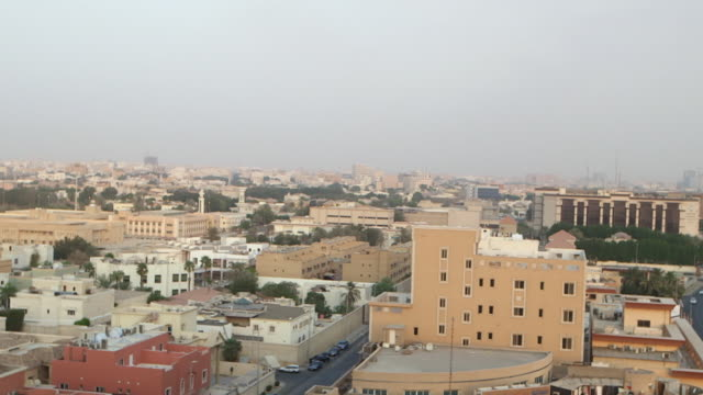 high-angle pan-right across jeddah cityscape. - jiddah stock videos & royalty-free footage