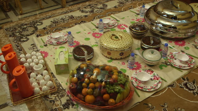highangle panright of crockery and food set on the floor - dining room stock videos & royalty-free footage