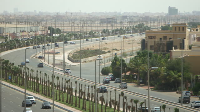 high-angle pan-right of jeddah skyline. - tourist stock videos & royalty-free footage
