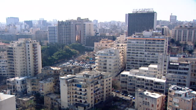 vídeos de stock, filmes e b-roll de high-angle ras beirut cityscape, with a view on gefinor center and the buildings surrounding it. ras beirut is the name given to the tip of the... - península
