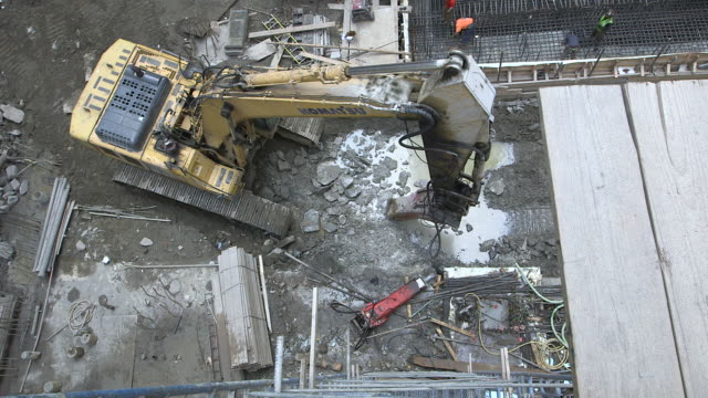 highangle sequence showing a large drill breaking up 'manhattan schist' at a construction site in new york usa fkax911w clip taken from programme... - schist stock videos and b-roll footage