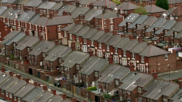 High-angle sequence showing terraced housing and other buildings in Newcastle-upon-Tyne, UK.