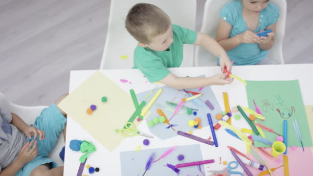 high-angle shot of a preschool arts and crafts class - craft stock videos & royalty-free footage