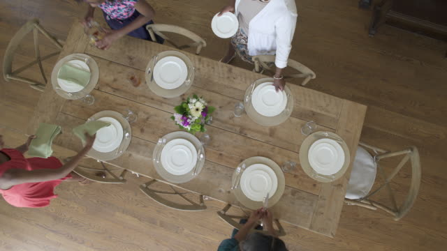 high-angle shot of women setting a table - dining table stock videos & royalty-free footage