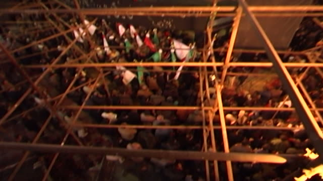 highangle tiltdown of men waving flags during ashura at a mosque in isfahan province ashura the tenth day of the islamic month of muharram... - baugerüst stock-videos und b-roll-filmmaterial