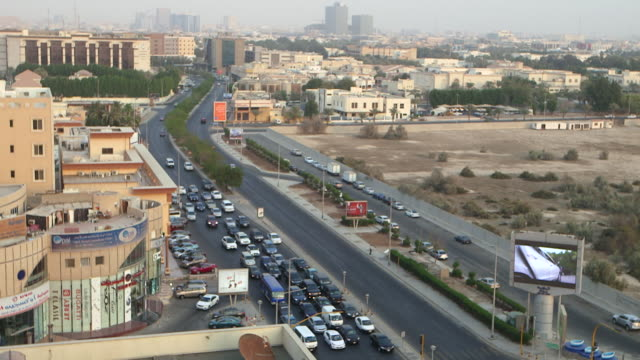 high-angle time lapse of traffic on a road in jeddah. - jiddah bildbanksvideor och videomaterial från bakom kulisserna